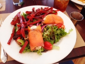 The dressing served with this salad compliments perfectly. That's crab rolled in the smoked salmon!